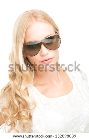 Portrait of a woman in sunglasses isolated