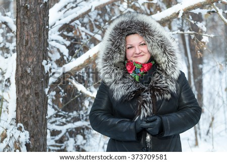 Portrait of a woman in the winter forest.