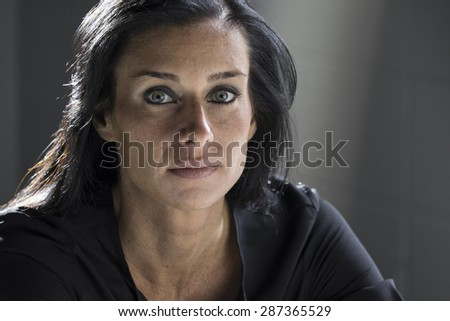 Portrait of a woman looking serious, worried - stock photo