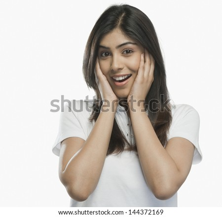 Portrait of a woman looking surprised - stock photo
