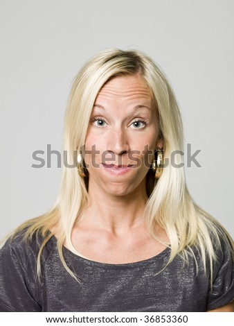 Portrait of a woman making a funny face - stock photo