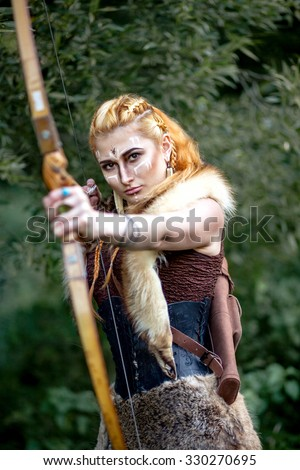 Portrait of a woman of the Amazon. Woman warrior hunting. Keep the bow in his hands. - stock photo