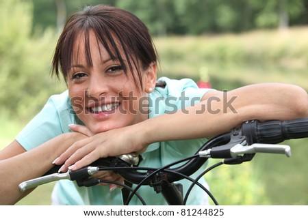 portrait of a woman on a bike - stock photo