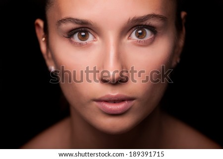 Portrait of a woman on black background - stock photo