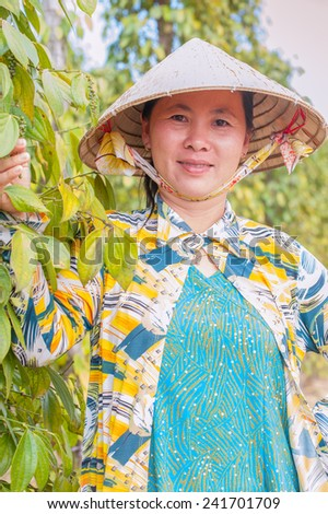 Portrait of a woman on the background of pepper plantations
