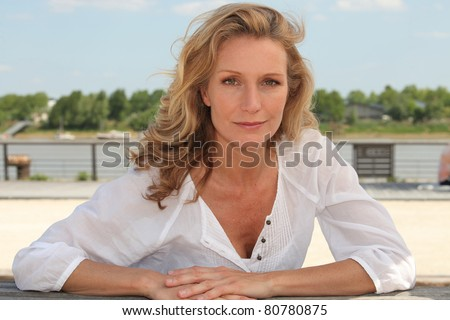 portrait of a woman outdoors - stock photo