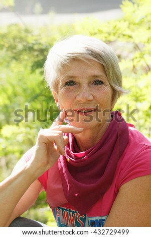 Portrait of a woman over 50 - stock photo