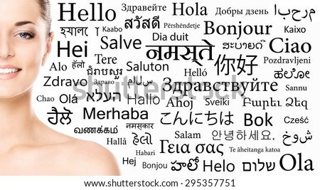 Portrait of a woman over the background with a different world languages (language school concept) - stock photo
