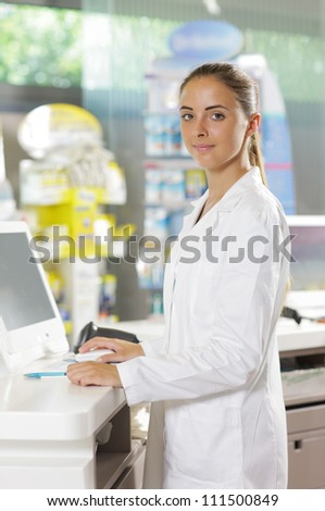 Portrait of a woman pharmacist in pharmacy - stock photo
