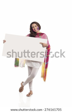 Portrait of a woman pointing to a white board - stock photo