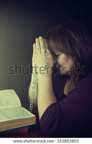 Portrait of a woman praying. - stock photo