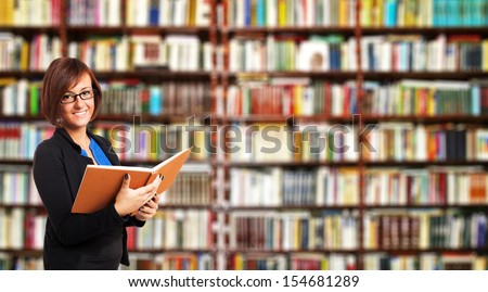 Portrait of a woman reading a book - stock photo
