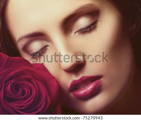 Portrait of a woman's face with rose - stock photo