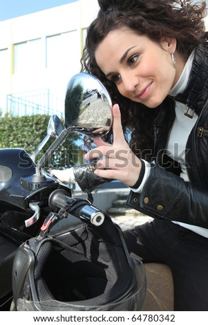 Portrait of a woman sitting on a motorcycle