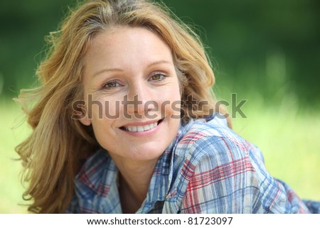 portrait of a woman smiling - stock photo