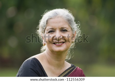 Portrait of a woman smiling in a park
