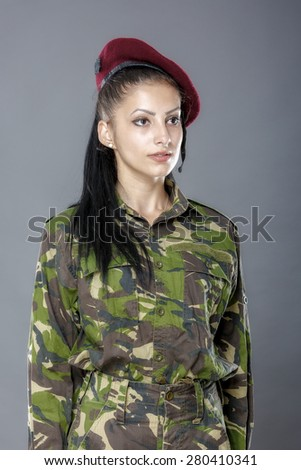 portrait of a woman soldier isolated on gray background