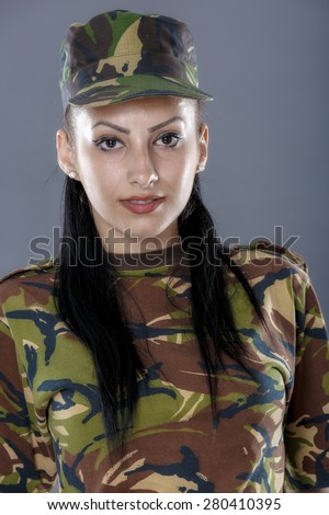 portrait of a woman soldier isolated on gray background - stock photo