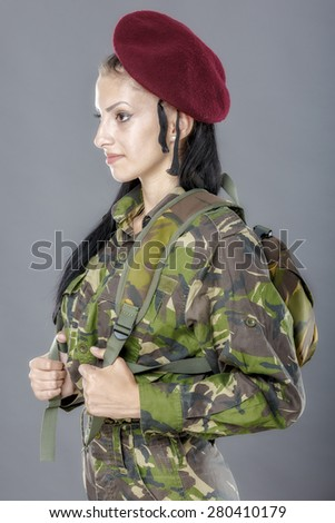 portrait of a woman soldier with backpack - stock photo