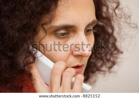 Portrait of a woman speaking on telephone