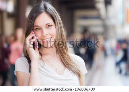 Portrait of a woman talking on the cell phone - stock photo