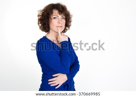 Portrait of a woman thinking, isolated on white background - stock photo