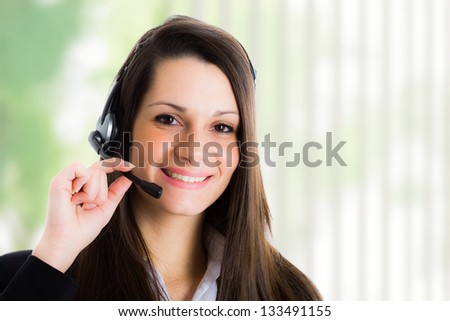 Portrait of a woman using an headset