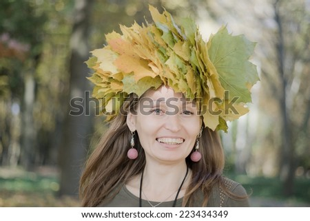 portrait of a woman wearing a wreath of maple leaves  - stock photo