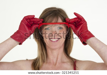 Portrait of a woman wearing safetly glasses and red gloves
