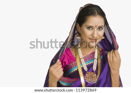 Portrait of a woman wearing sari and smiling - stock photo