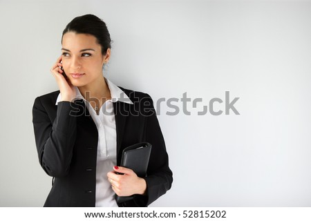 Portrait of a woman with a cell phone - stock photo