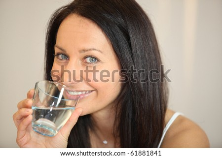 Portrait of a woman with a glass of water - stock photo