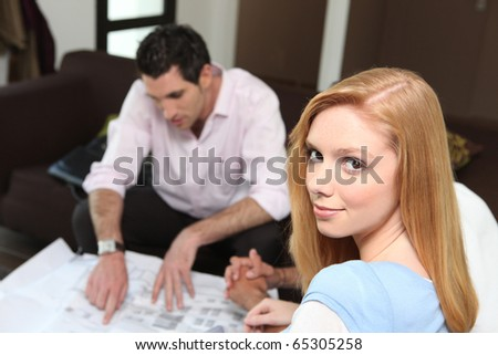 Portrait of a woman with a real estate agent - stock photo