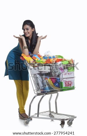 Portrait of a woman with a shopping cart