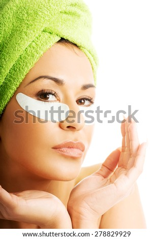 Portrait of a woman with an eye mask. - stock photo