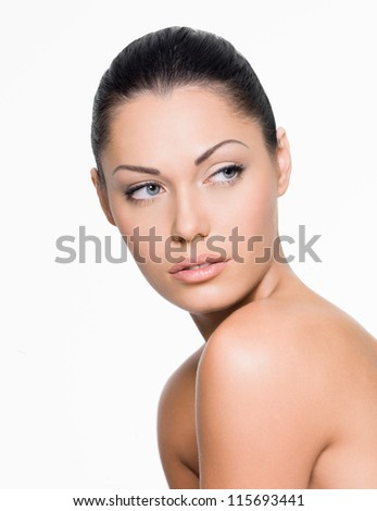 Portrait of a woman with beautiful face looking side- isolated on white - stock photo