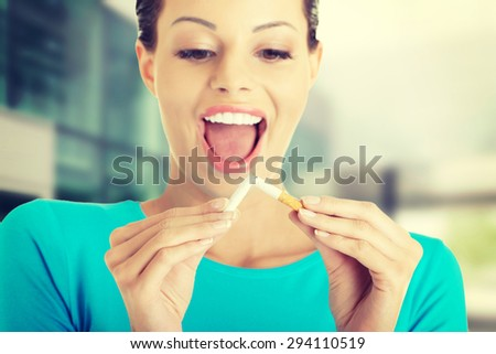 Portrait of a woman with broken cigarette - stock photo
