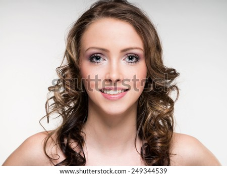 Portrait of a woman with brunette hair / Woman - stock photo