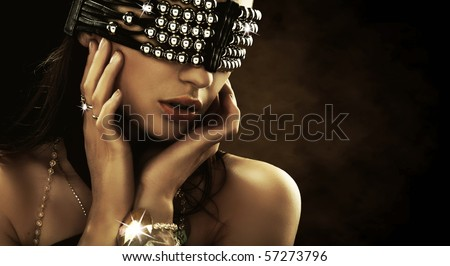 Portrait of a woman with covered eyes - stock photo