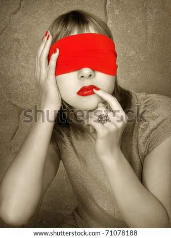Portrait of a woman with covered eyes. Red lips and manicure - stock photo