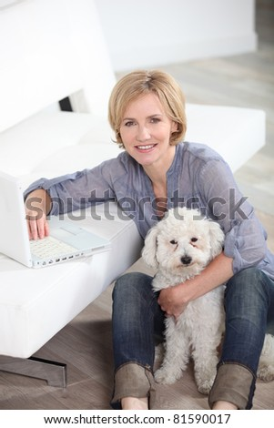 portrait of a woman with dog - stock photo