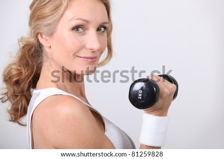 portrait of a woman with dumbbell - stock photo