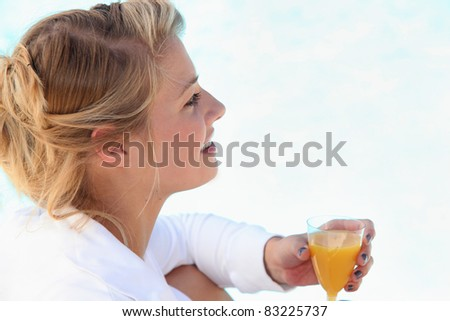 portrait of a woman with glass of orange juice