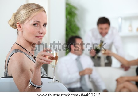 portrait of a woman with glass of wine - stock photo