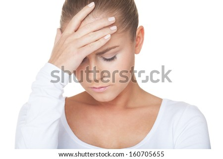 Portrait of a woman with headache - stock photo