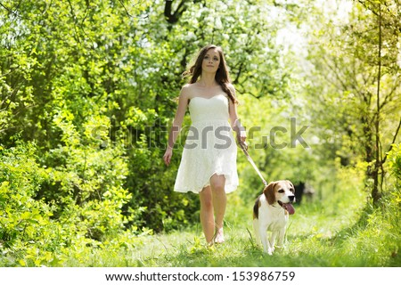 Portrait of a woman with her beautiful dog outdoors - stock photo