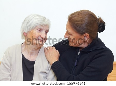 Portrait of a woman with her elderly mother - stock photo