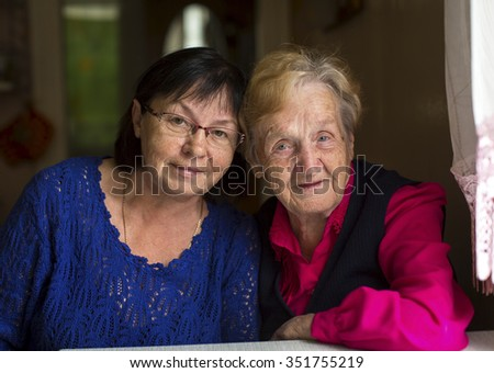 Portrait of a woman with his old mother.