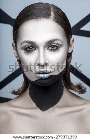 Portrait of a woman with long lashes and make-up in black and white style on the background with black stripes - stock photo