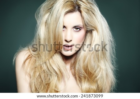 Portrait of a woman with lush blond hair.